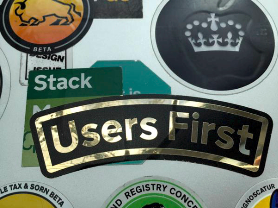 Sticker that reads 'Users first'
