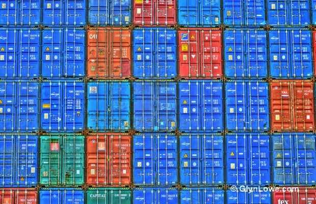 Photo of shipping containers stacked up
