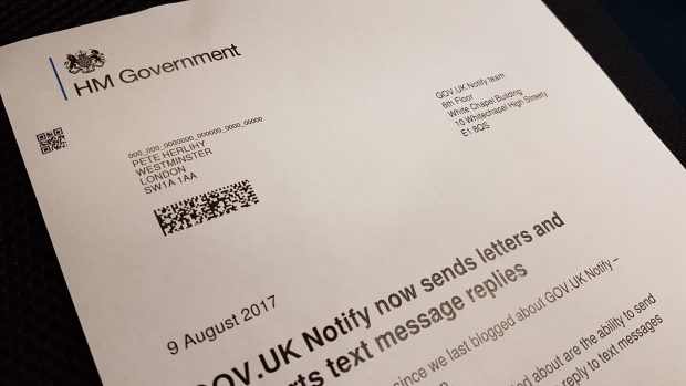 A letter sent from the GOV.UK Notify team sits on a table