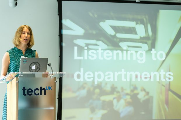 Hazel Hobbs presenting to an audience at techUK